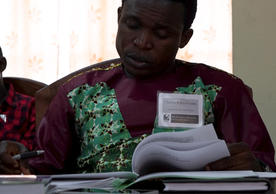 Sierra Leonean teacher, Charles, reads through the handouts before a lecture